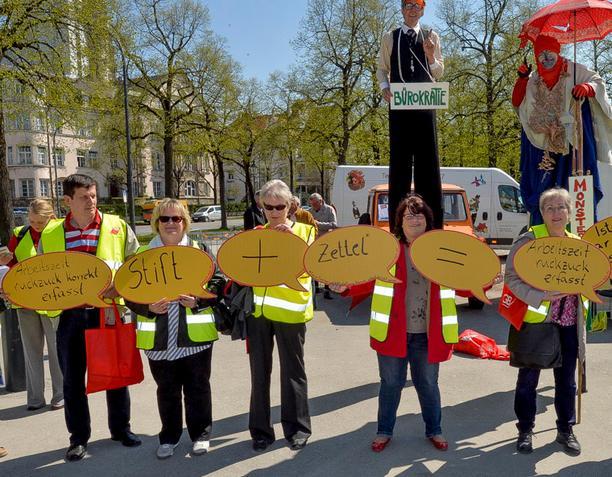 Aktion gegen die Einschränkung des Mindestlohns im München