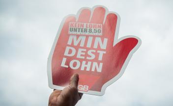 Mindestlohn-Plakat, Hand