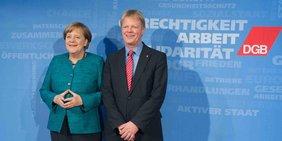 Bundeskanzlerin Angela Merkel und DGB-Vorsitzender Reiner Hoffmann