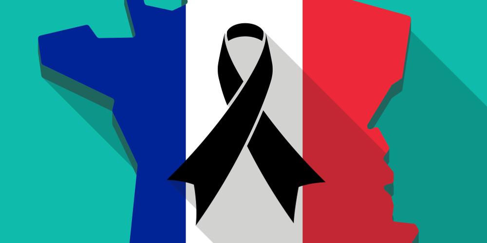Umrisse Frankreichs in Nationalfarben mit schwarzer Trauerschleife