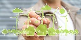 Hand zeichnet Symbole für erneuerbare Energien und Klima