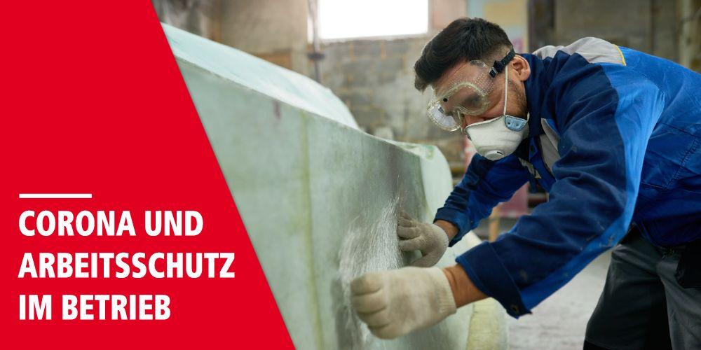 """Arbeiter mit Mundschutz und Schutzbrille, Schriftzug """"Corona und Arbeitsschutz im Betrieb"""""""