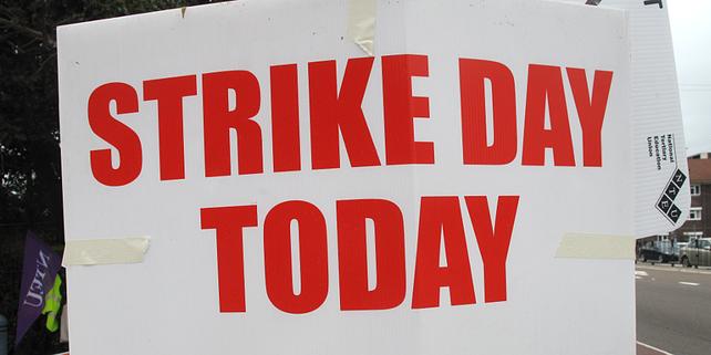 englischsprachiges Streik-Plakat