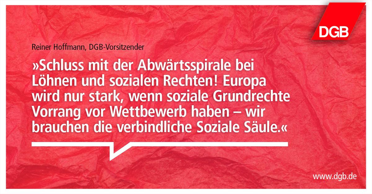 """Weiße Schrift auf rotem Grund: """"DGB-Vorsitzender Reiner Hoffmann: 'Schluss mit der Abwärtsspirale bei Löhnen und sozialen Rechten! Europa wird nur stark, wenn soziale Grundrechte Vorrang vor Wettbewerb haben – wir brauchen die verbindliche Soziale Säule.'"""""""