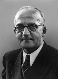 Portrait von Christian Fette mit Brille. Blick in die Kamera.