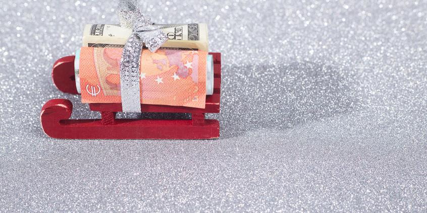 Kleiner Schlitten mit Banknoten