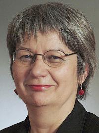 Portrait von Ingrid Sehrbrock. Blick zur Kamera.
