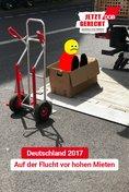 """Plakat-Motiv: """"Deutschland 2017 - Auf der Flucht vor hohen Mieten"""""""