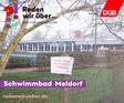 """Schwimmbad Meldorf und Bothel mit """"Hier muss investiert werden""""-Schild"""